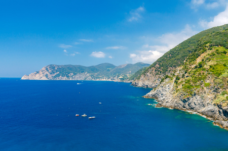 reference point: Scenic view in Sunny day on the coastline of the Cinque Terre. Italy. Liguria. Stock Photo