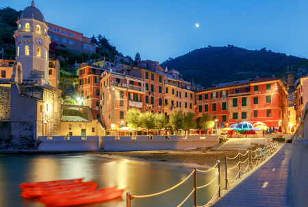 The old main square on the waterfront in the Italian village of Vernazza at night. Parco Nazionale delle Cinque Terre, Liguria, Italy. Stock Photo