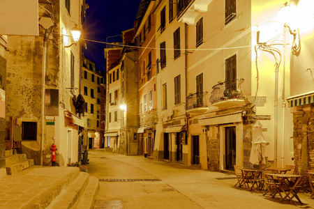 reference point: Old, narrow, medieval streets in the Italian village Vernazza at night. Cinque Terre National Park, Liguria, Italy. Stock Photo