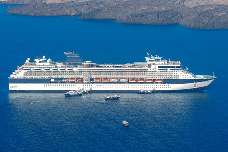 old ship: Passenger ship in the old port of Fira early sunny morning. Santorini. Greece. Stock Photo
