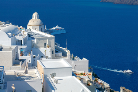 Passenger ship in the old port of Fira early sunny morning. Santorini. Greece. Stock Photo