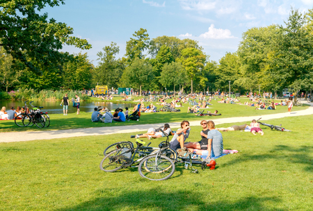 Amsterdam, The Netherlands - August 27, 2016: Vondelpark a favorite place for rest and walking residents and tourists. The park has good infrastructure for cyclists. Editöryel