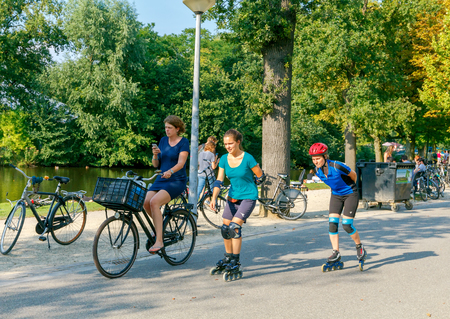 reference point: Amsterdam, The Netherlands - August 27, 2016: Vondelpark a favorite place for rest and walking residents and tourists. The park has good infrastructure for cyclists. Editorial