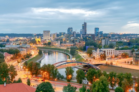 Scenic view from the top of Gediminas Hill to the center of Vilnius and Neris river at night.