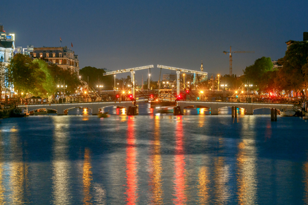 The Skinny Bridge (Magere Brug) at night. Amsterdam. Netherlands.