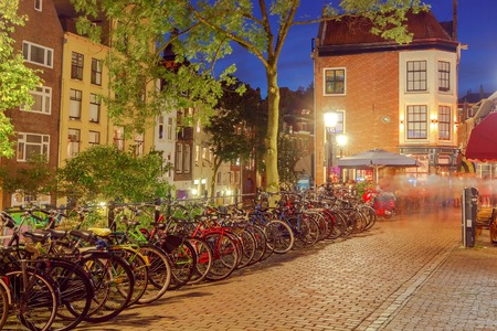 Traditional urban street with lights at night in Utrecht. Netherlands.
