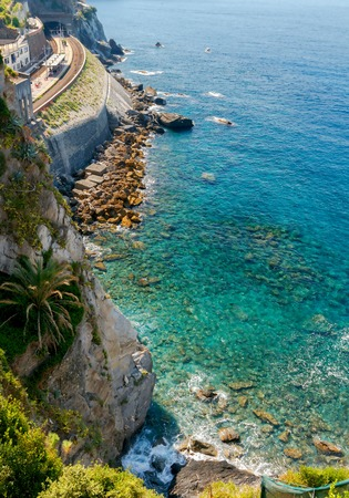 reference point: Scenic view in Sunny day on the coastline about Manarola. Cinque Terre. Italy. Liguria.