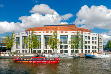 excursions: Amsterdam, The Netherlands - August 29, 2016: Excursions by boat on the canals of Amsterdam. Favorite place for walking and leisure travelers.