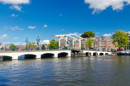 amstel: Adjustable skinny bridge over the Amstel River. Amsterdam. Netherlands.