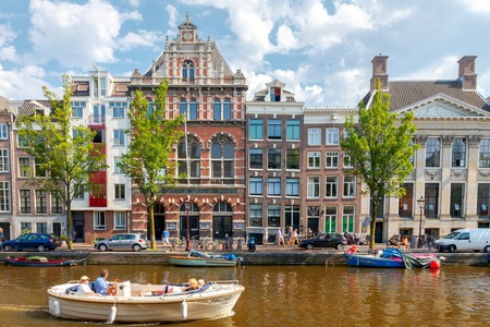 excursions: Amsterdam, Netherlands - August 26, 2016: Excursions by boat on the canals of Amsterdam. Favorite place for walking and leisure travelers.
