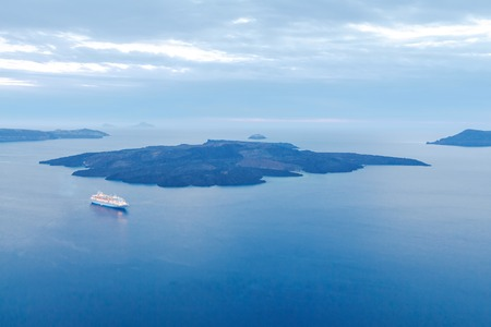 reference point: Passenger ship with lighted lanterns in the Bay. Santorini. Greece. Stock Photo