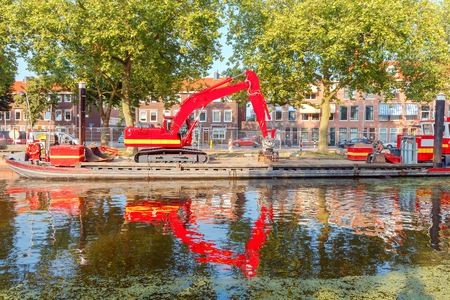 The Dutch city Delft with the channel in the green duckweed. Stock Photo