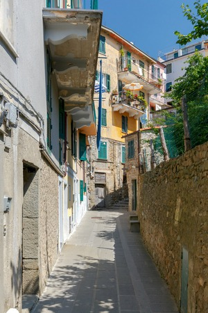reference point: Traditional narrow street in the famous medieval village of Corniglia. Cinque Terre. Italy.