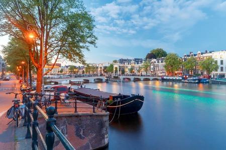 amstel: Skinny Bridge in night illumination and the river Amstel.