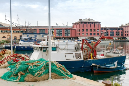 mol: Fishing multi-colored boats in the old port of Genoa. Italy.