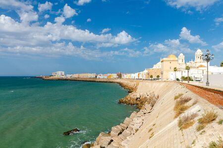 Stone Town Quay with lanterns along the Atlantic Ocean. Cadiz. Spain. Andalusia. Stock Photo