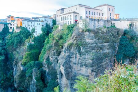 reference point: Buildings on a cliff above the gorge in Ronda. Spain. Andalusia.