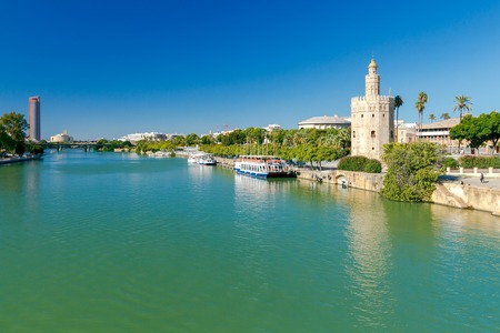 Golden Tower (Torre del Oro) on the banks of the Guadalquivir River. Sevilla. Andalusia. Spain.