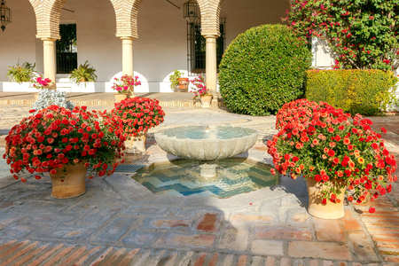 spanish home: Patio with fountain and flowers in the interior space a Spanish home.