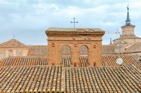mancha: Traditional tiled roofs on old houses in Toledo. Spain. Castilla la Mancha.
