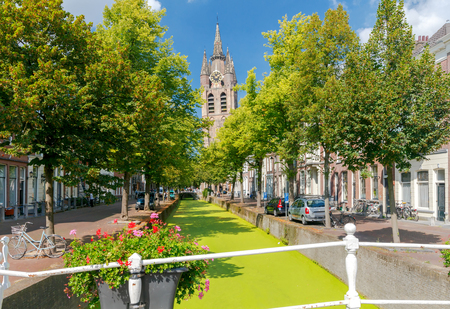 The Dutch city Delft with the channel in the green duckweed. Netherlands. Stock Photo - 66827111