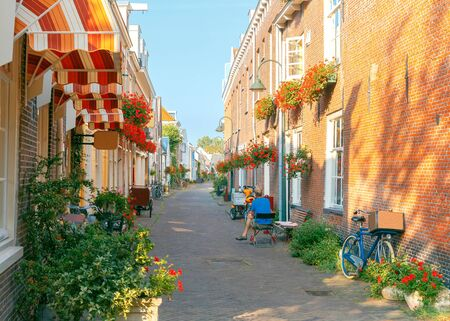 Traditional Dutch narrow street in Delft. Netherlands. Stock Photo