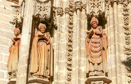 inquisition: Stone carving and sculptures on the walls of the cathedral in Seville. Stock Photo