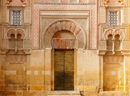 Golden Gate entrance to the La Mezquita - Catedral de Cordoba. Cordoba, Andalusia, Spain. Imagens