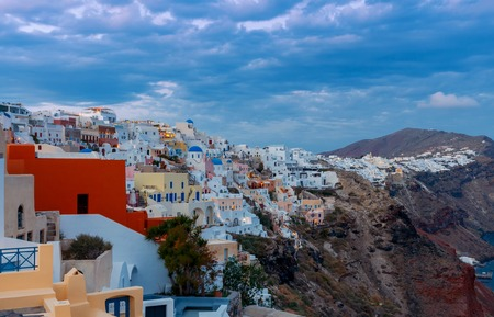 volcano slope: Beautiful night view of the village Oia, Santorini Island, Greece. Stock Photo