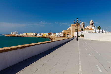 Stone Town Quay with lanterns along the Atlantic Ocean. Cadiz. Spain. Andalusia. Stock Photo