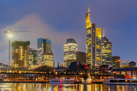 Picturesque views of the citys waterfront and skyscrapers at night in Frankfurt. Germany.