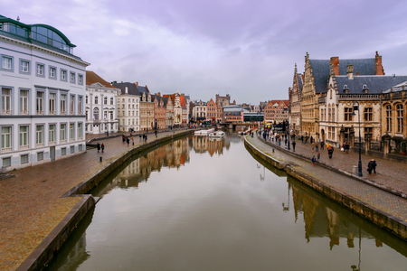 Facades of old medieval houses on the central waterfront in Ghent on the sunset. Stock Photo