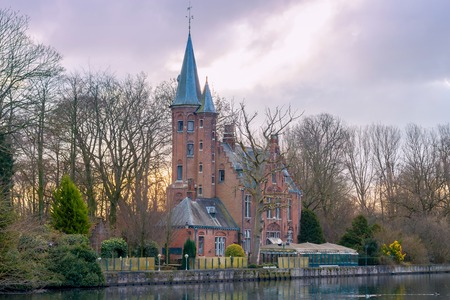 Old park Minnewater and lake in Bruges. One of the favorite tourist attractions.