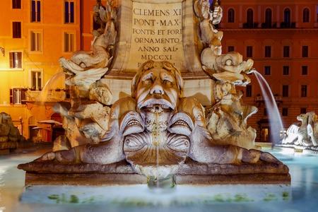 rotunda: The famous fountain on Piazza della Rotonda in front of the Pantheon at hight. Rome. Italy. Stock Photo