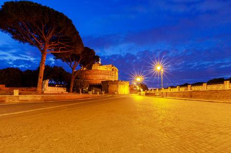 Castel SantAngelo and SantAngelo bridge across the river Tiber in the night light. Rome. Italy.