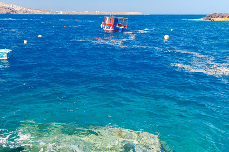 Old Port in the village Oia on Santorini island in the Aegean Sea. Greece.
