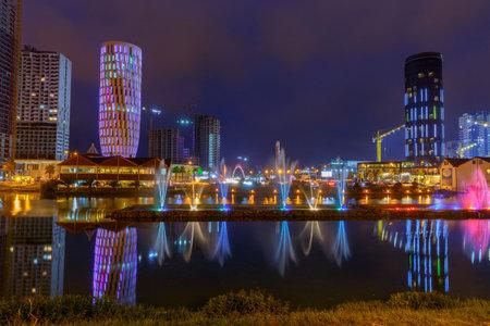 Batumi, Georgia - September 15, 2017: Dancing colorful fountains on Lake Ardogani in the night illumination. Batumi. Georgia. Adjara