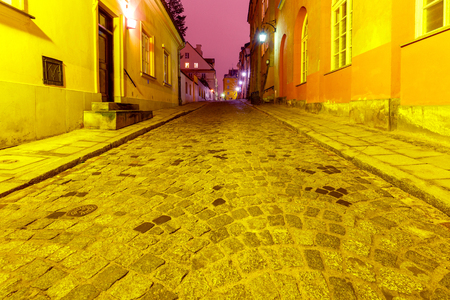 Warsaw. Street in the old city at night.