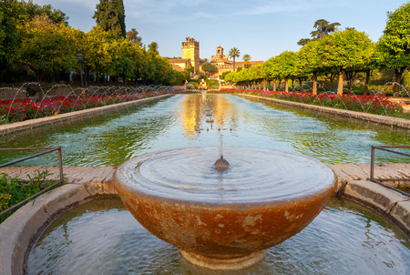 Flowering gardens and fountains of the Alcazar de los Reyes Cristianos, Cristian royal palace of the Kings, Cordoba, Andalusia, Spain.