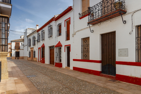 The narrow traditional street in the city of Ronda. Andalusia. Spain. Editorial