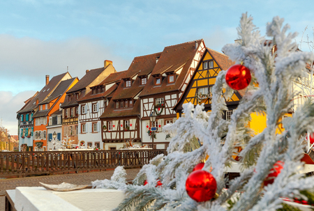 Medieval multicolored half-timbered houses on canals on Christmas Day. Colmar. France. Alsace. 免版税图像