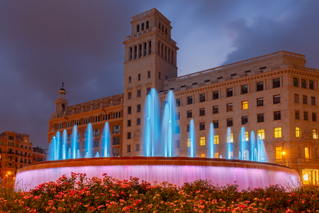 Multicolored fountain on the square Catalunya in the night illumination. Barcelona. Spain.