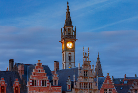 Gent. Clock tower at sunset.