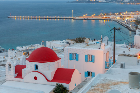 Aerial view of the city Chora from a hill on the sunset. Greece. The island Mykonos. Imagens - 110195190