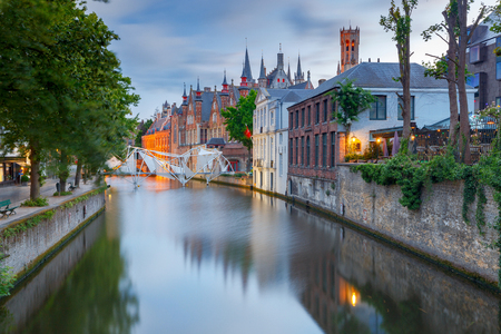 View of the green canal in the night illumination at sunset. Brugge. Belgium.