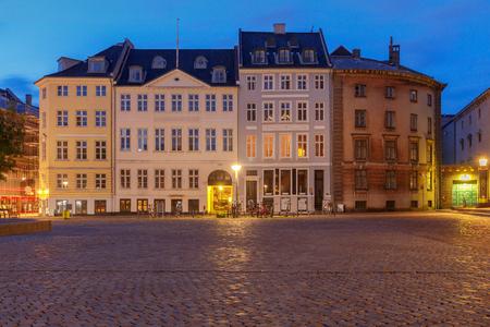 Square Amagertorv in night lighting at sunrise. Copenhagen. Denmark.
