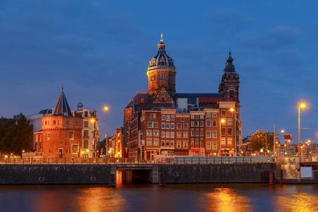 Scenic evening view of the church of St. Nicholas in Amsterdam. Netherlands.