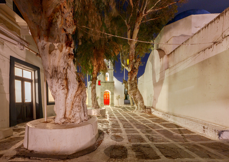 A traditional little white church in the city Chora at night. The island of Mykonos. Greece.