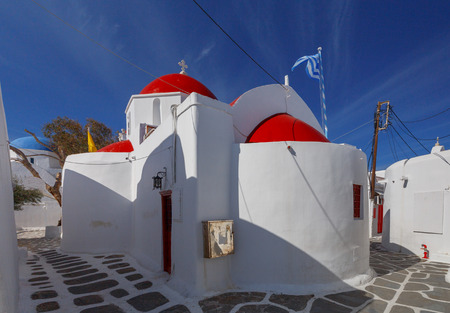 A traditional little white church in the city Chora. The island Mykonos. Greece.