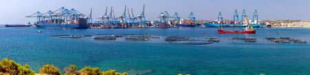 Panoramic view of cargo pore vessels and container terminal. Marsaxlokk. Malta.